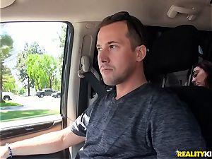 Monique Alexander blows a huge cock in the car