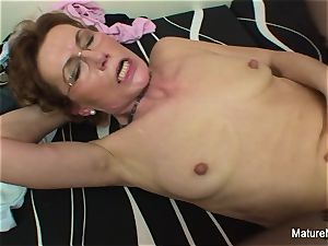 Mature tramp with glasses loves getting pummeled
