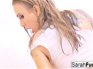 spectacular inked bombshell Sarah fucks herself in the bathroom