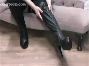 jaw-dropping assistant slowly pulls on her leather thigh boots