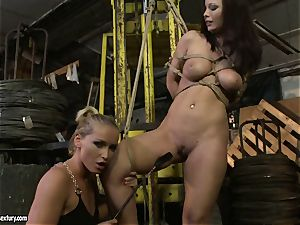 Kathia Nobili spanking the butt of steaming doll with crop