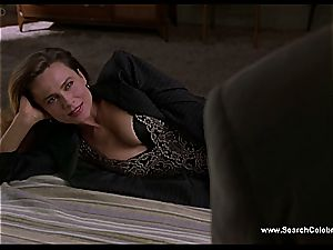brunette Lena Olin in underwear flashes off her petite orbs