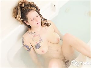tattooed Misty draining With Water Jets