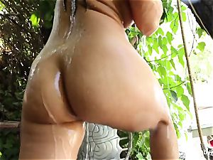 big-boobed brown-haired Abigail Mac takes a douche