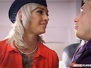 Stewardess Kleio Valentien plays with her passengers creating turbulence